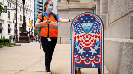 A woman wearing a mask to prevent the spread of COVID-19 casts her ballot in the primary election in Philadelphia,
