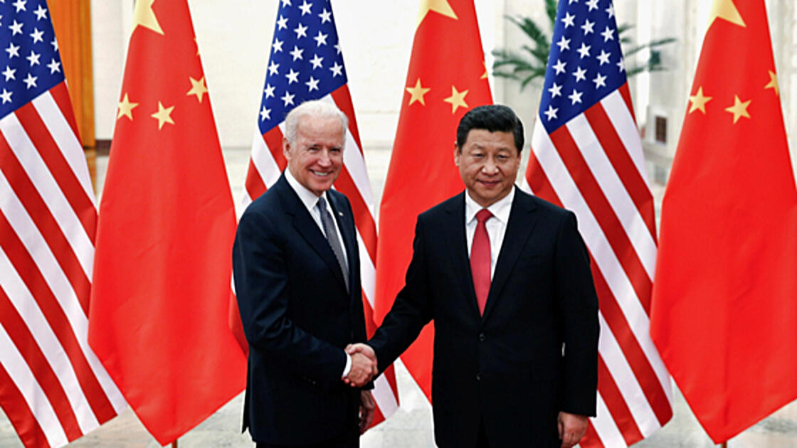Chinese President Xi Jinping shakes hands with U.S. Vice President Joe Biden inside the Great Hall of the People in Beijing