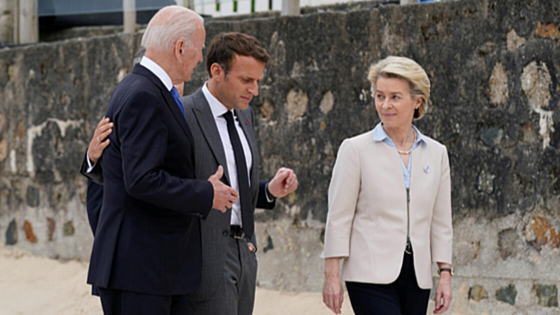 U.S. President Joe Biden speaks with French President Emmanuel Macron and European Commission President Ursula von der Leyen