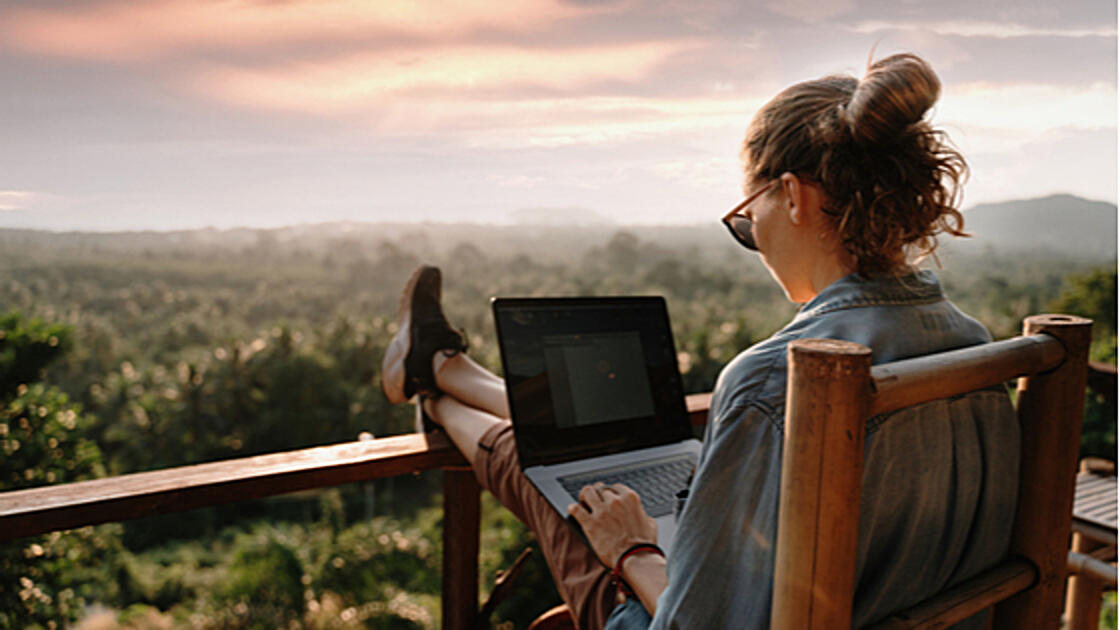 Woman remote working on porch
